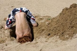 Boy digging a hole