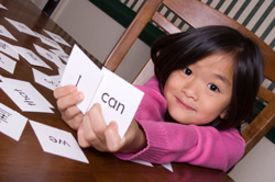 Girl holding sight words flash cards